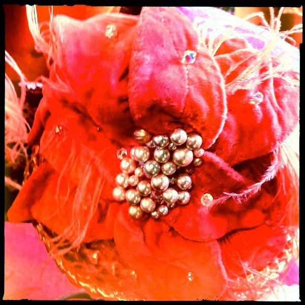 coral hat with pearls